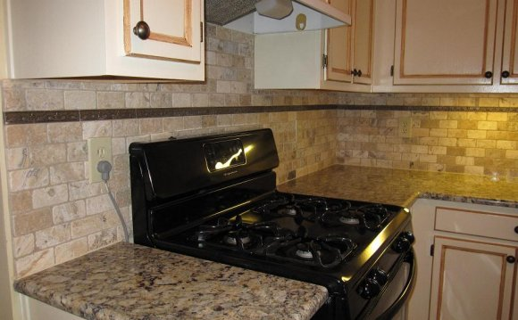 Tumbled stone subway tile backsplash