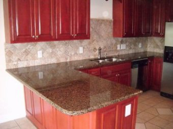 an attractive backsplash accenting an excellent countertop!