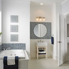 Decorative tile accent around a bath tub