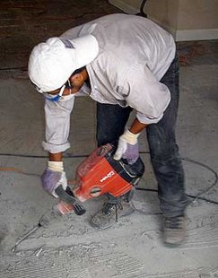 Jack hammer for tile elimination