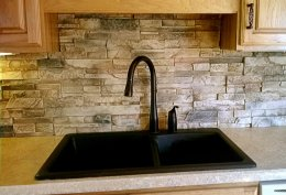 Kitchen backsplash produced from faux drystack stone panels