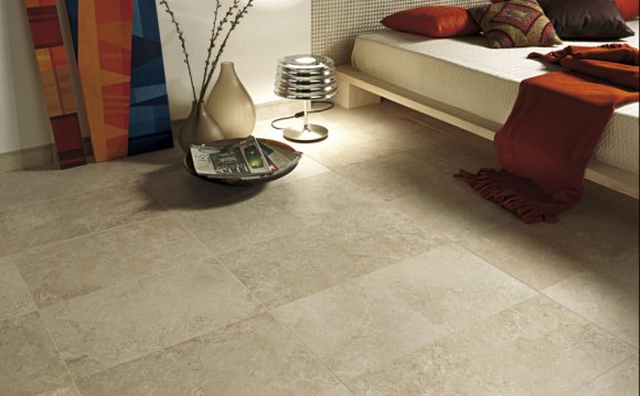 Laying stone floor tiles on concrete