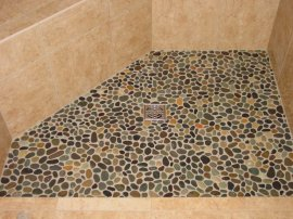 Shows rounded river stones in a shower floor.
