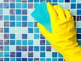 Cleaning pool Tile with pumice stone