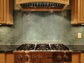 Green stone tile backsplash