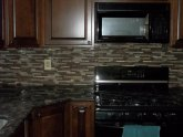 Grouting glass stone mosaic tile backsplash