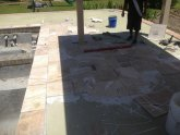 Installing Travertine over tile
