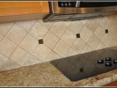 Natural stone tile backsplash install