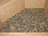 Pebble stone shower floor installation