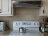 Stone subway tile kitchen backsplash