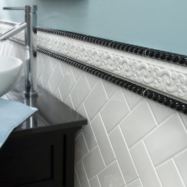 White subway tiles in chevron design
