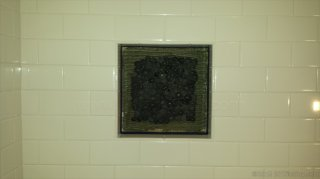 mini pebble tile niche